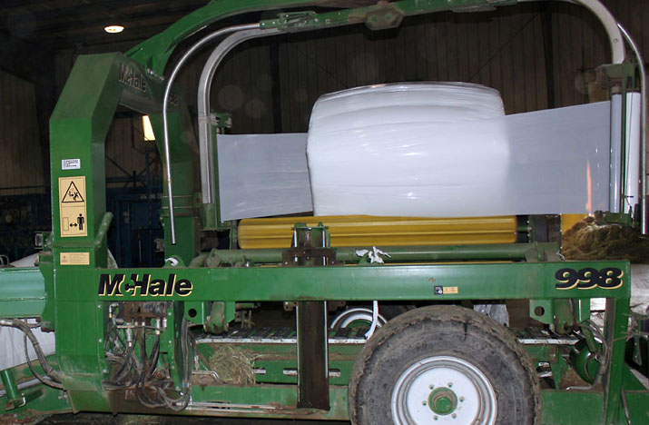 Compressed Sweet Hay bale being wrapped for shipment.